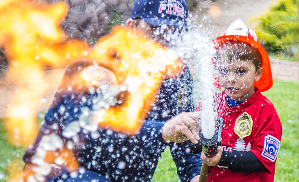 child learning to put out fire
