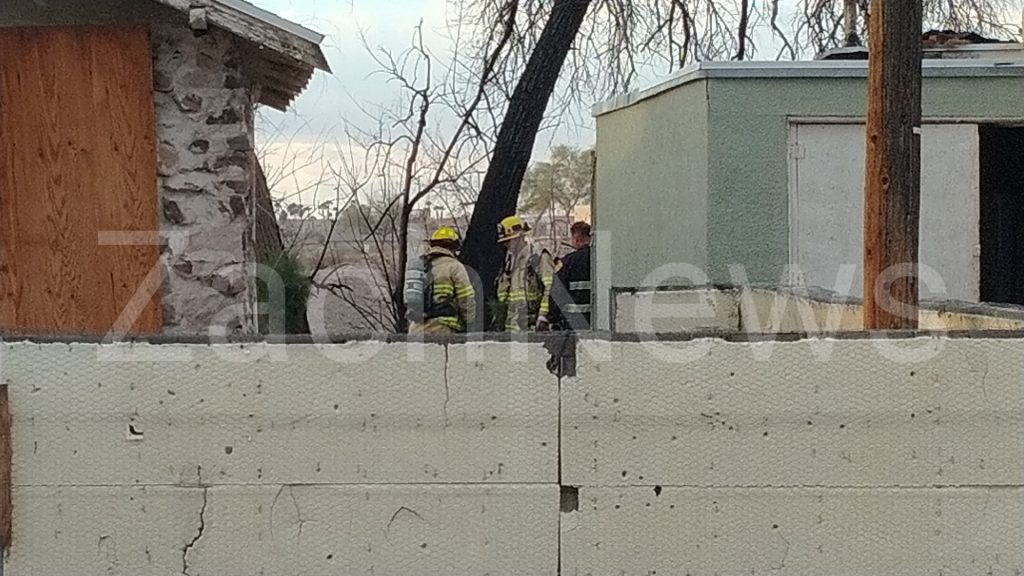 Basement fire inside a burned vacant residential structure along the 1,500 block of Washington Street