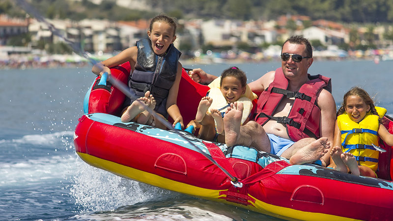 family on raft in water