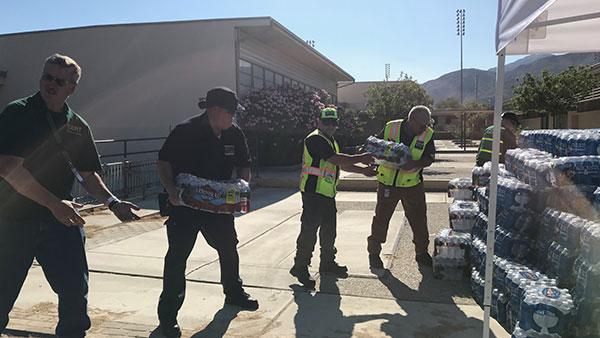 volunteers collecting water