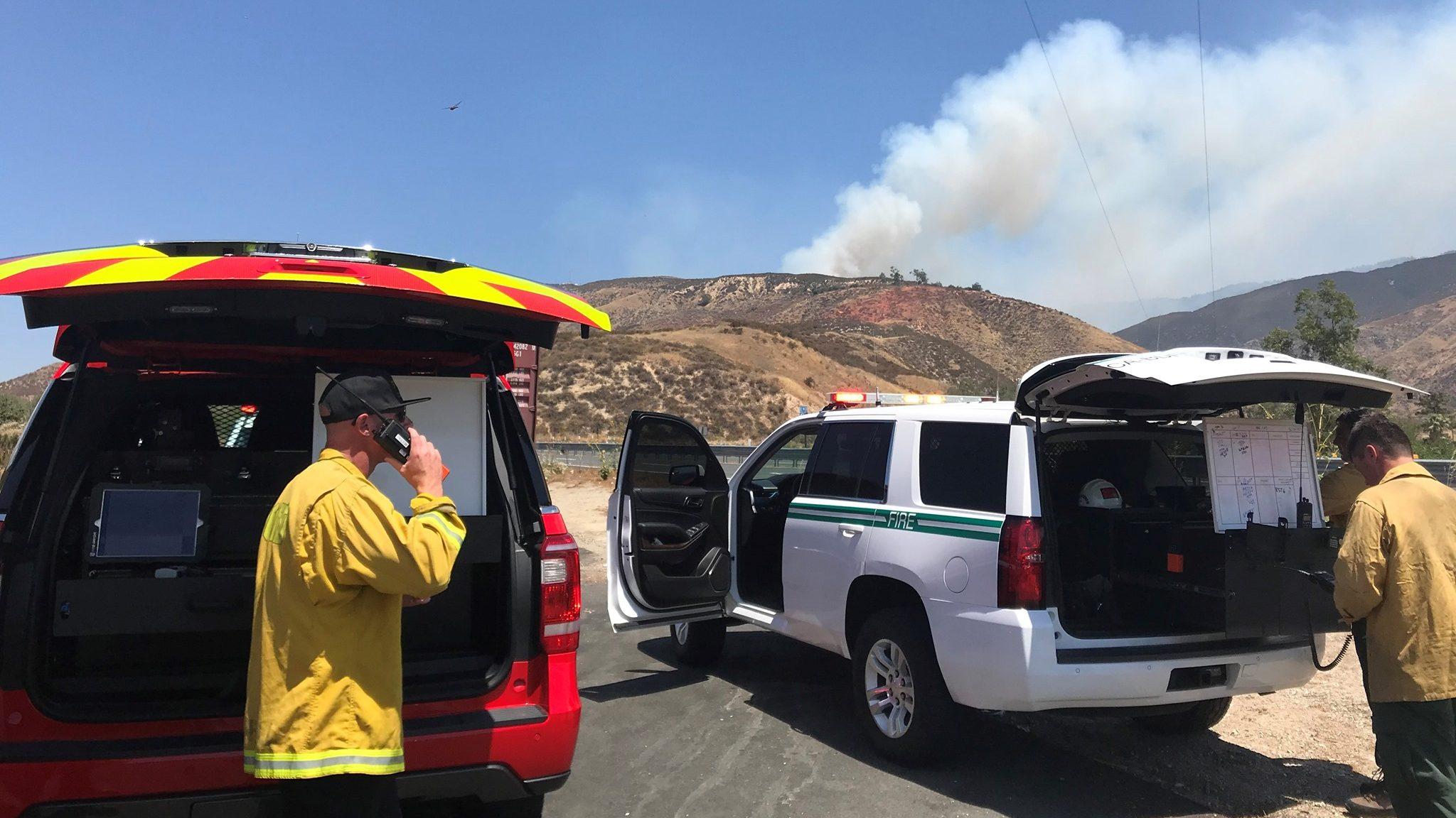 Peak Fire's rapid spread near San Bernardino prompts Highway 18 closure; firefighter injured.